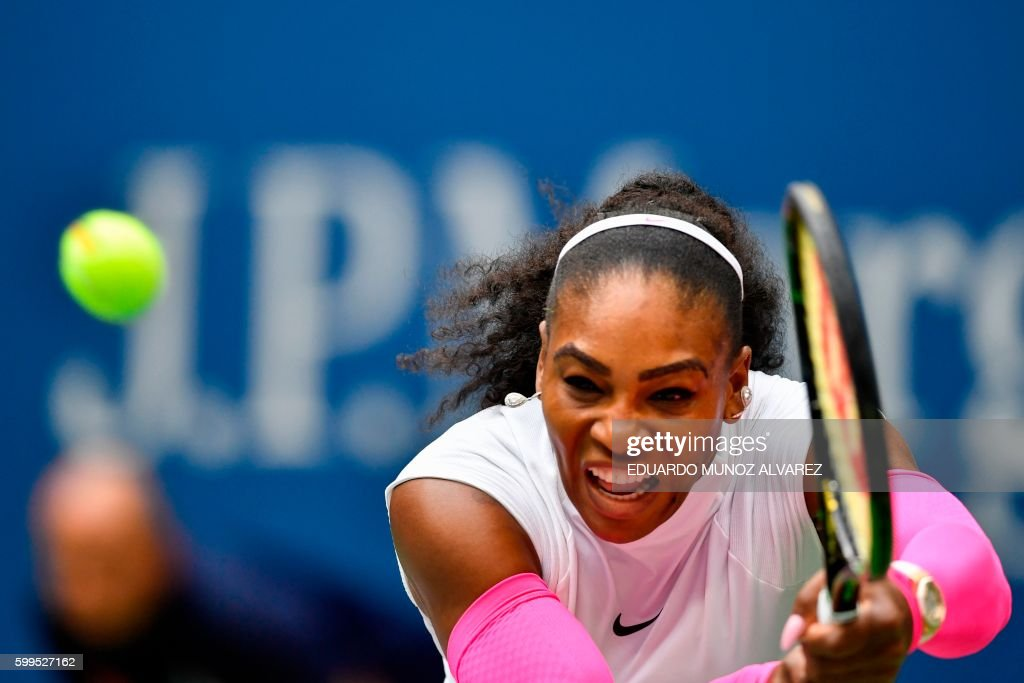 TOPSHOT - Serena Williams of US hits a return against Yaroslava Shvedova of Kazakhstan during their 2016 US Open Women's Singles match at the USTA Billie Jean King National Tennis Center in New York on September 5, 2016. /