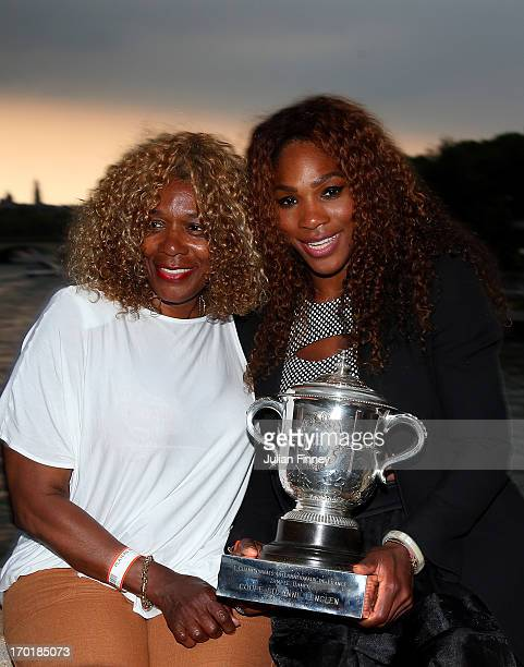 Serena Williams of USA and mother Oracene Price pose with the Coupe Suzanne Lenglen trophy in front of the Eiffel Tower after her win over Maria...