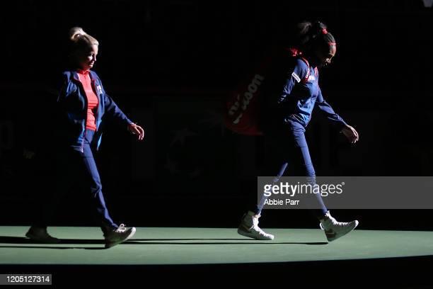 Serena Williams of USA and Team USA captain Kathy Rinaldi take the court prior to taking on Anastasija Sevastova of Latvia during the 2020 Fed Cup...