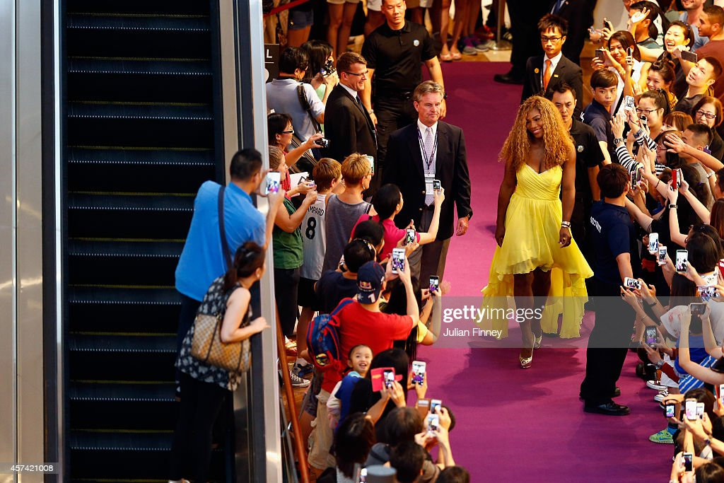Serena Williams of USA arrives at the draw during previews for the WTA Finals at the Marina Bay Sands Shopping centre on October 18, 2014 in Singapore.