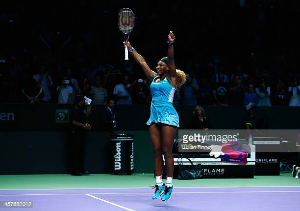 Serena Williams of USA celebrates at match point as she defeats Simona Halep of Romania in the final during day seven of the BNP Paribas WTA Finals...