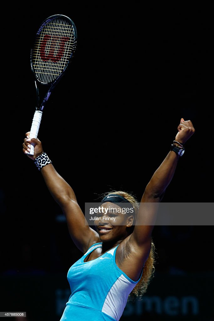 Serena Williams of USA celebrates at match point as she defeats Simona Halep of Romania in the final during day seven of the BNP Paribas WTA Finals tennis at the Singapore Sports Hub on October 26, 2014 in Singapore.