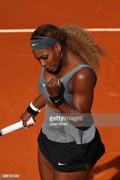 Serena Williams of USA celebrates defeating Belinda Bencic of Switzerland during day two of the Mutua Madrid Open tennis tournament at the Caja...