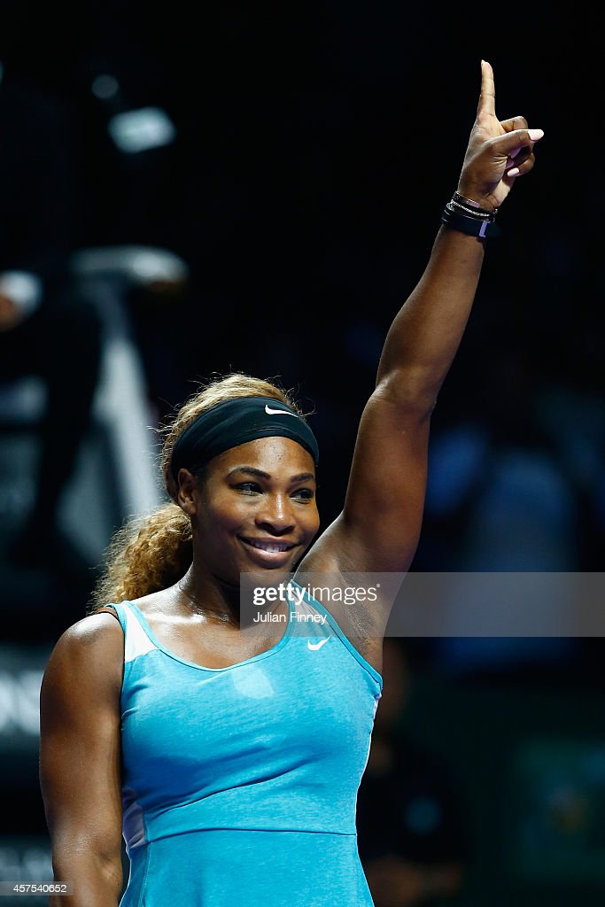 Serena Williams of USA celebrates winning her match against Ana Ivanovic of Serbia dduring day one of the BNP Paribas WTA Finals tennis at the Singapore Sports Hub on October 20, 2014 in Singapore.