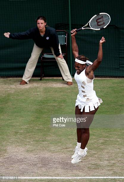 Serena Williams of USA celebrates winning her semifinal match against Amelie Mauresmo of France after Mauresmo's shot was called out at the Wimbledon...