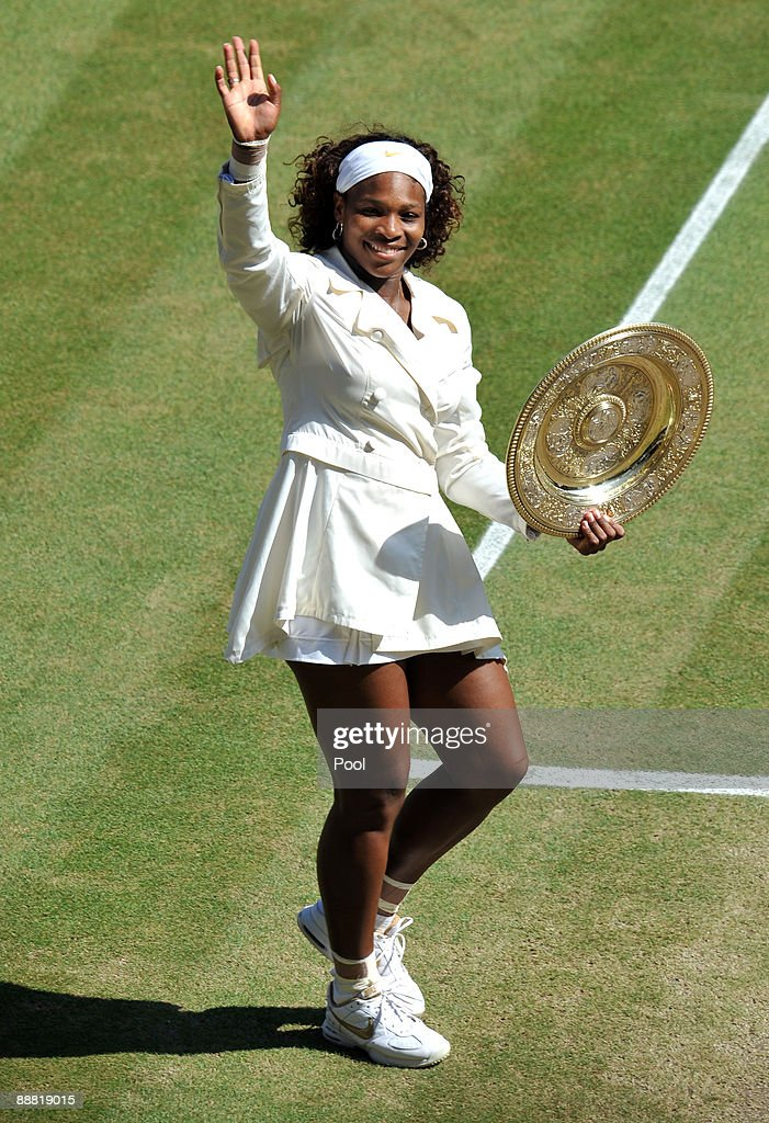 Serena Williams of USA celebrates with the Championship trophy after the women's singles final match against Venus Williams of USA on Day Twelve of the Wimbledon Lawn Tennis Championships at the All England Lawn Tennis and Croquet Club on July 4, 2009 in London, England. Serena Williams of USA won 7-6, 6-2.