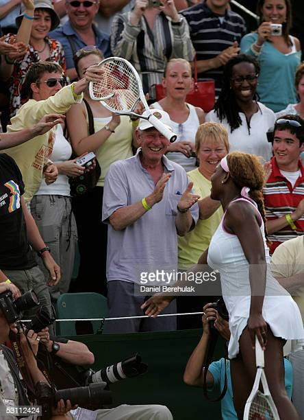 Serena Williams of USA damages her racquet against Angela Haynes of USA during the first round of the Wimbledon Lawn Tennis Championship on June 21,...