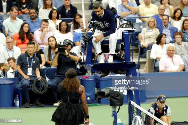Serena Williams of USA debates with the chair umpire Carlos Ramos as she competes against Naomi Osaka of Japan during US Open 2018 women's final...