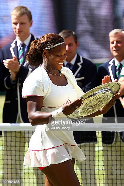 Serena Williams of USA holds the Championship trophy after winning her Ladies Singles Final Match against Vera Zvonareva of Russia on Day Twelve of...