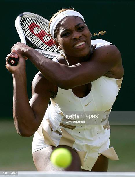Serena Williams of USA in action during her semi final match against Amelie Mauresmo of France at the Wimbledon Lawn Tennis Championship on July 1...