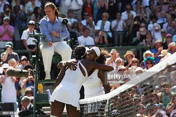 Serena Williams of USA is congratulated by sister Venus Williams of USA as she is victorious during the women's singles final match on Day Twelve of...