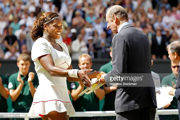 Serena Williams of USA is presented the Championship trophy by the Duke of Kent after winning her Ladies Singles Final Match against Vera Zvonareva...