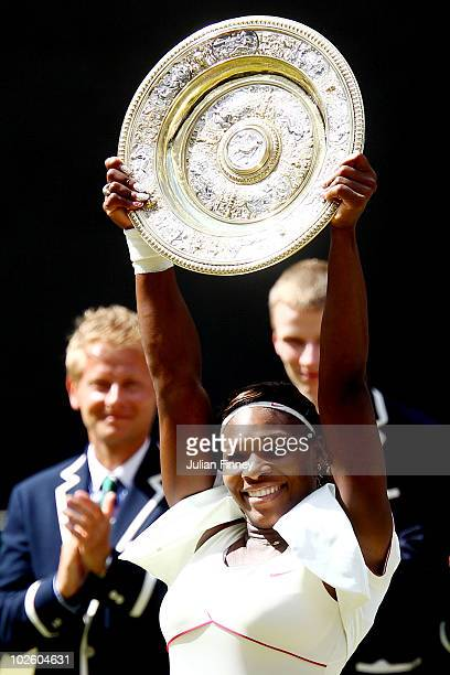 Serena Williams of USA lifts the Championship trophy after winning her Ladies Singles Final Match against Vera Zvonareva of Russia on Day Twelve of...