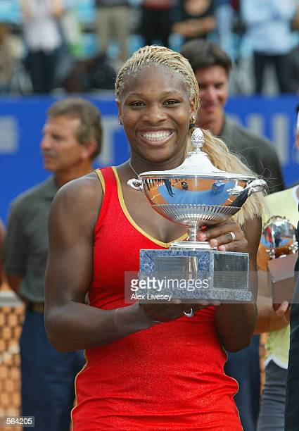 Serena Williams of USA lifts the Italian Open Trophy after defeating Justine Henin of Belgium 7-6, 6-4 in the final during the WTA Tennis Masters...