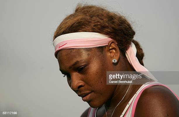 Serena Williams of USA looks on against Angela Haynes of USA during the first round of the Wimbledon Lawn Tennis Championship on June 21, 2005 at the...
