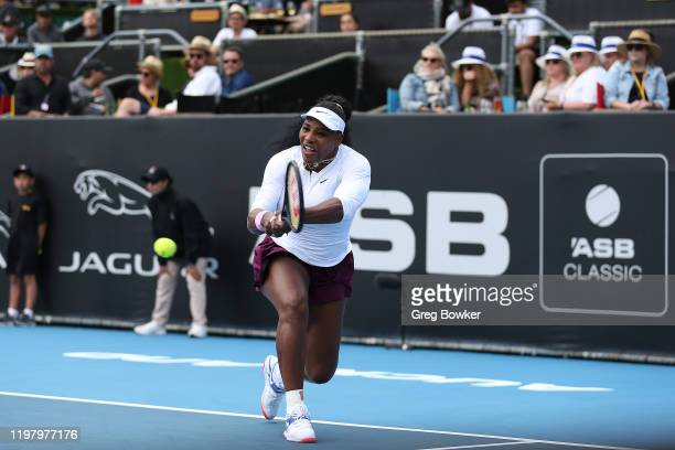 Serena Williams of USA plays a backhand in her first round match against Camila Giorgi of Italy during day two of the 2020 ASB Classic at ASB Tennis...