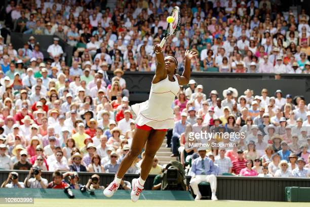 Serena Williams of USA plays a shot during the Ladies Singles Final Match against Vera Zvonareva of Russia on Day Twelve of the Wimbledon Lawn Tennis...