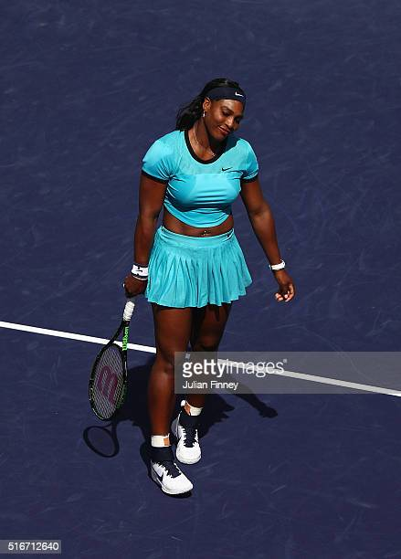 Serena Williams of USA reacts in her match against Victoria Azarenka of Belarus in the final during day fourteen of the BNP Paribas Open at Indian...
