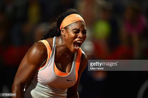 Serena Williams of USA screams after winning a point against Anastasia Pavlyuchenkova of Russia in their Second Round match on Day Three of The...