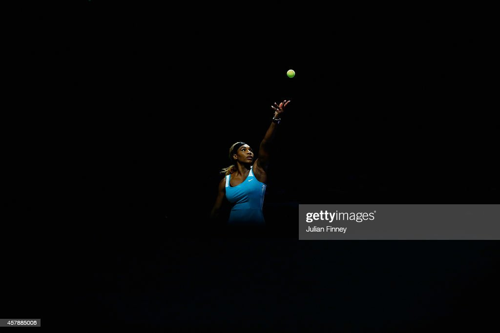Serena Williams of USA serves to Simona Halep of Romania in the final during day seven of the BNP Paribas WTA Finals tennis at the Singapore Sports Hub on October 26, 2014 in Singapore.