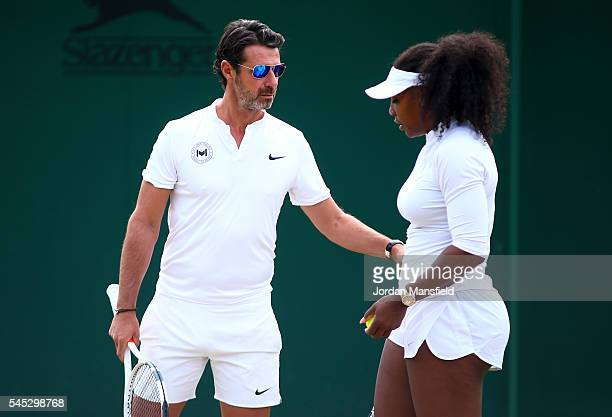 Serena Williams of USA with coach Patrick Mouratoglou during a practice session on day ten of the Wimbledon Lawn Tennis Championships at the All...