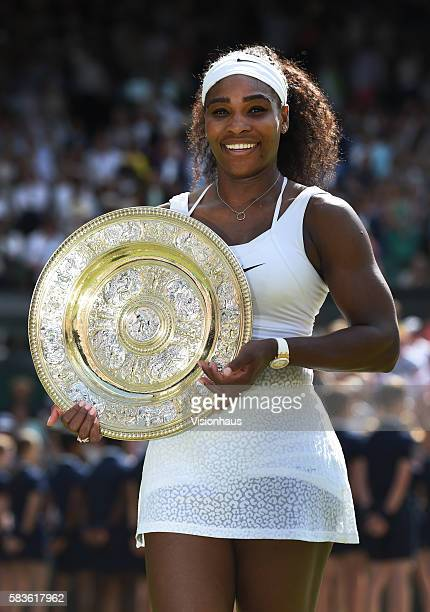 Serena Williams of USA with the trophy after winning the womens singles final against Garbine Muguruza of Spain on Day Twelve of the 2015 Wimbledon...