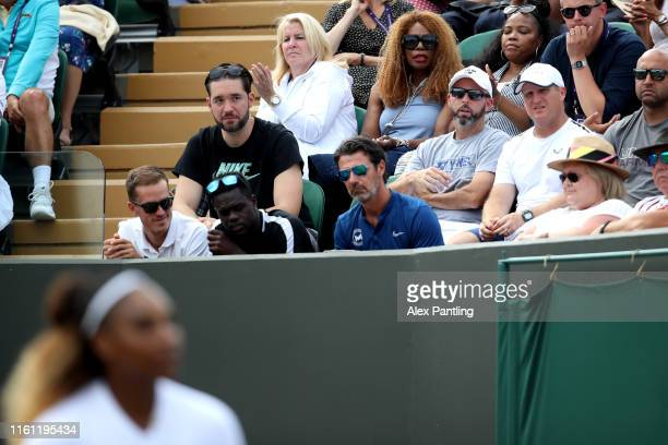 Serena Williams player box looks on during the Mixed Doubles third round match between Serena Williams of the United States, Andy Murray of Great...