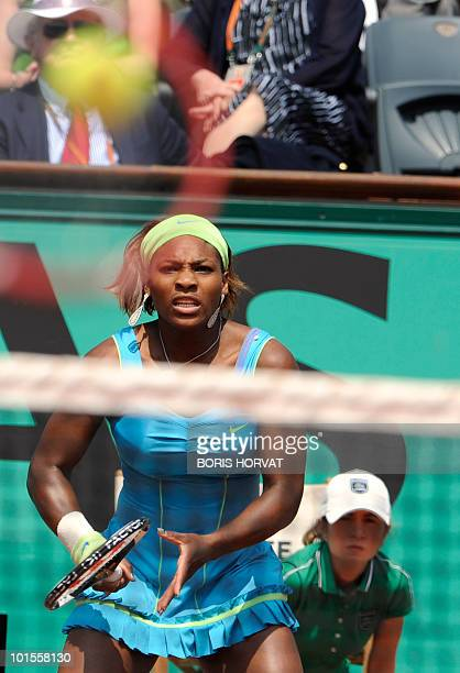 Serena Williams plays a return during her women's quarter-final against Australia's Samatha Stosur in the French Open tennis championship at the...