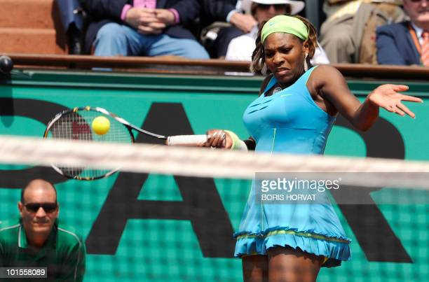 Serena Williams plays return during her women's quarter-final against Australia's Samatha Stosur in the French Open tennis championship at the Roland...