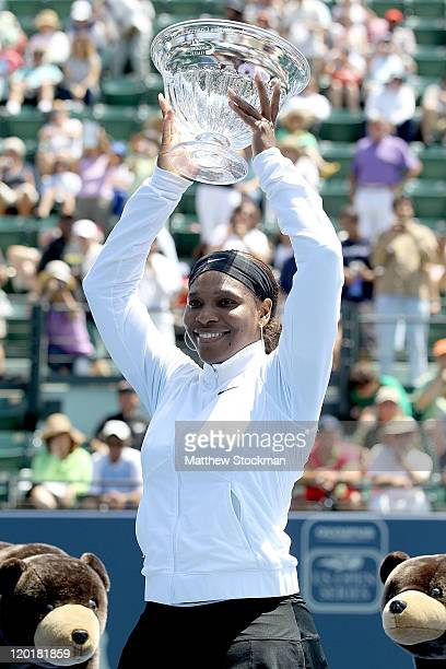 Serena Williams poses for photographers after her win over Marion Bartoli of France during the final of the Bank of the West Classic at the Taube...