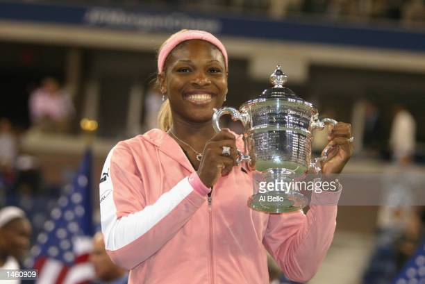 Serena Williams poses with her winning trophy after the finals at the US Open September 7, 2002 at the USTA National Tennis Center in Flushing...