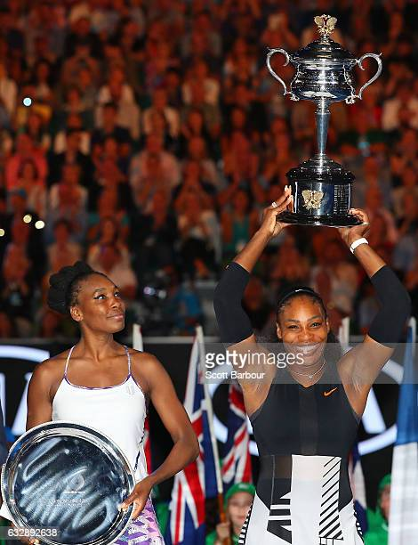 Serena Williams poses with the Daphne Akhurst Trophy after winning the Women's Singles Final against Venus Williams of the United States posing with...