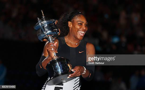 Serena Williams poses with the Daphne Akhurst Trophy after winning the Women's Singles Final against Venus Williams of the United States on day 13 of...