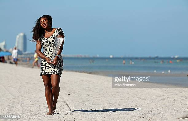 Serena Williams poses with the trophy at Crabdon Park after winning the Women's Final of the Miami Open presented by Itau against Carla Suarez...