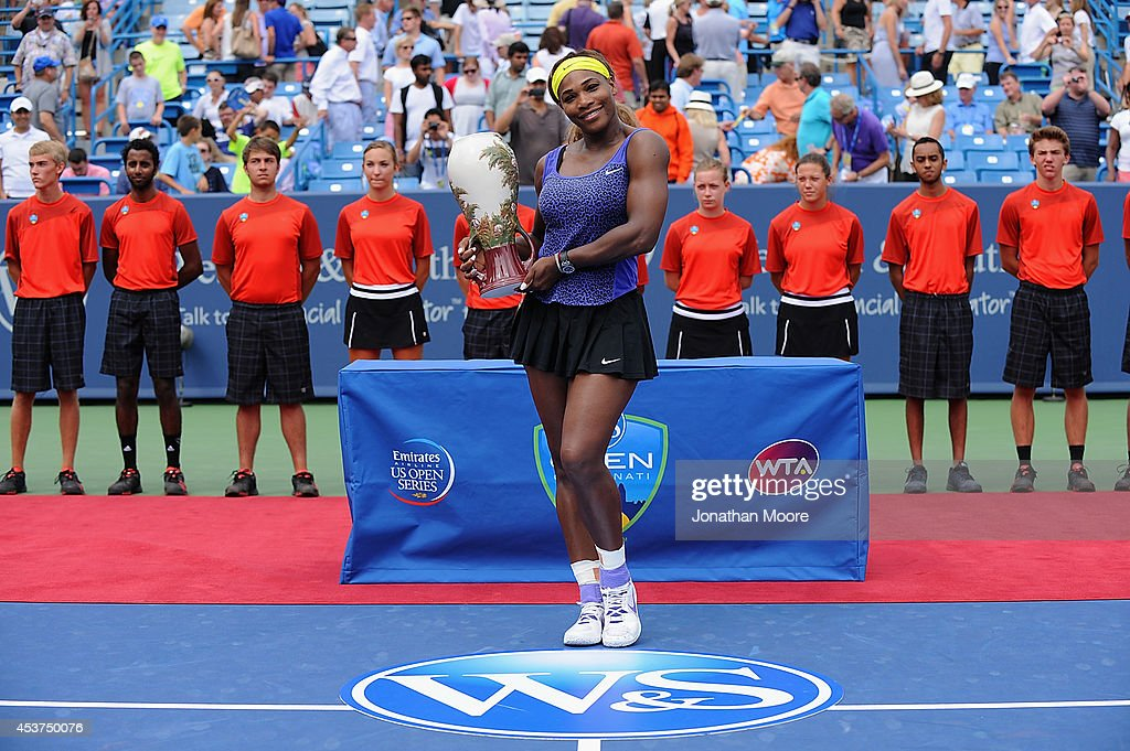 Serena Williams poses with the winner's trophy during the trophy ceremony after a final match against Ana Ivanovic of Serbia on day 9 of the Western & Southern Open at the Linder Family Tennis Center on August 17, 2014 in Cincinnati, Ohio.