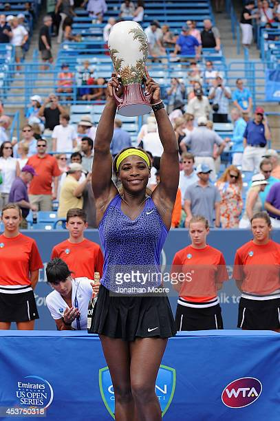 Serena Williams poses with the winner's trophy during the trophy ceremony after a final match against Ana Ivanovic of Serbia on day 9 of the Western...