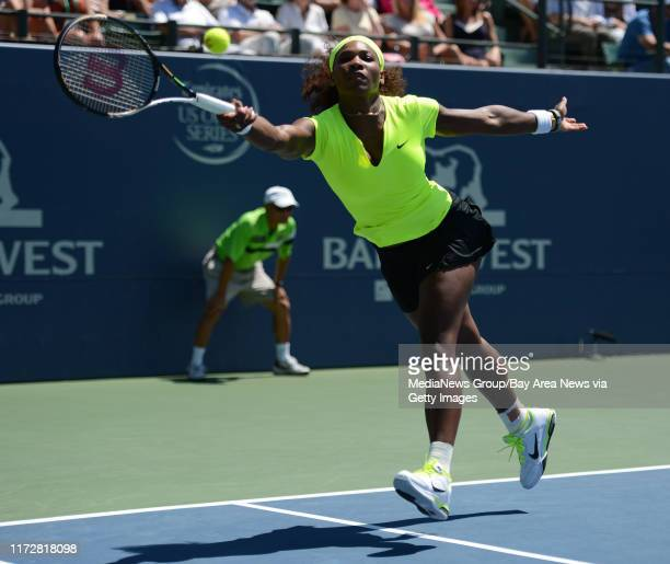 Serena Williams reaches for the ball in the second set of her finals match against Coco Vandeweghe for the Bank of the West Classic tennis tournament...