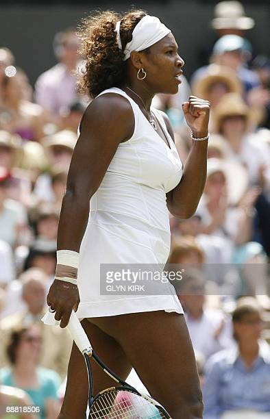 Serena Williams reacts to play against US Venus Williams during their final match on Day 12 at the 2009 Wimbledon tennis championships at the All...