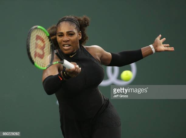 Serena Williams returns a forehand to Kiki Bertens of the Netherlands during the BNP Paribas Open on March 10 2018 at the Indian Wells Tennis Garden...