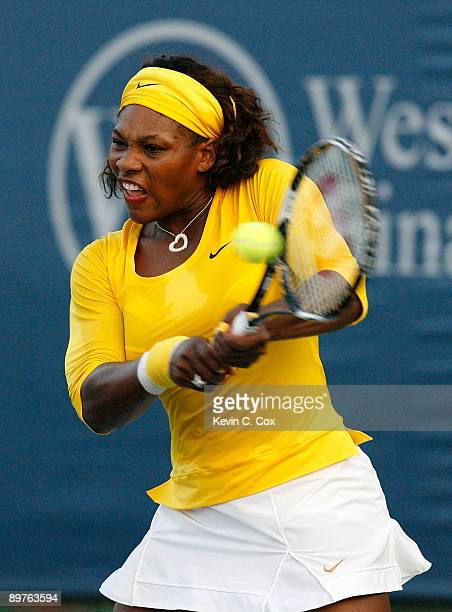 Serena Williams returns a shot against Kateryna Bondarenko of Ukraine during Day 3 of the Western Southern Financial Group Women's Open on August 12...