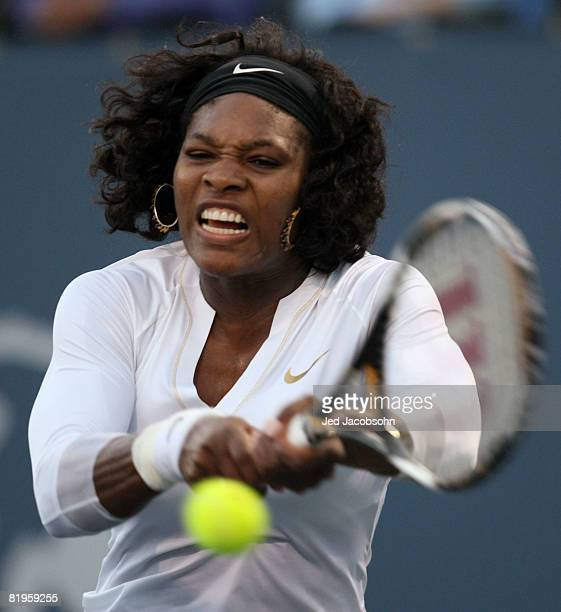 Serena Williams returns a shot against Michelle Larcher De Brito of Portugal during the Bank of the West Classic Day 3 at Stanford University July 16...