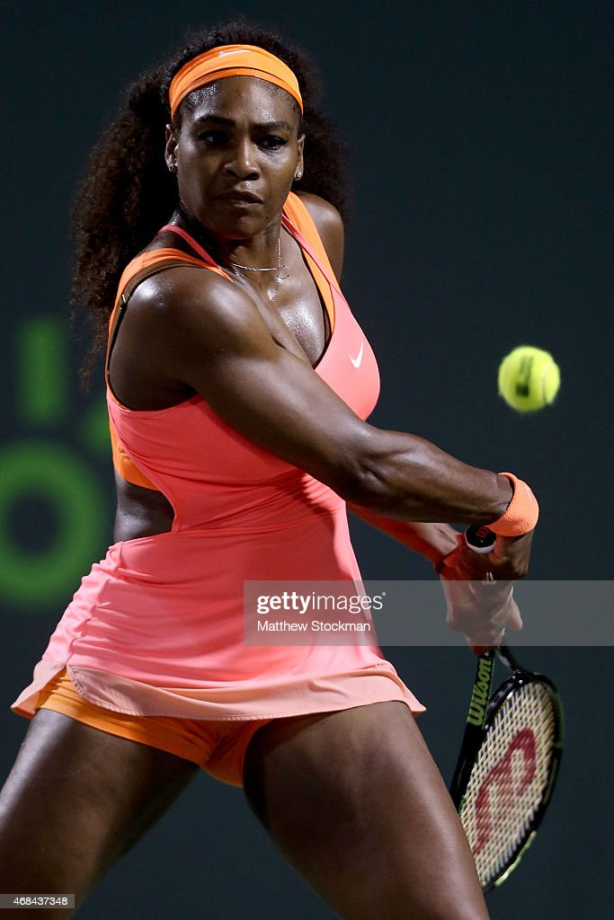 Serena Williams returns a shot to Simona Halep of Romania during day 11 of the Miami Open Presented by Itau at Crandon Park Tennis Center on April 2, 2015 in Key Biscayne, Florida.