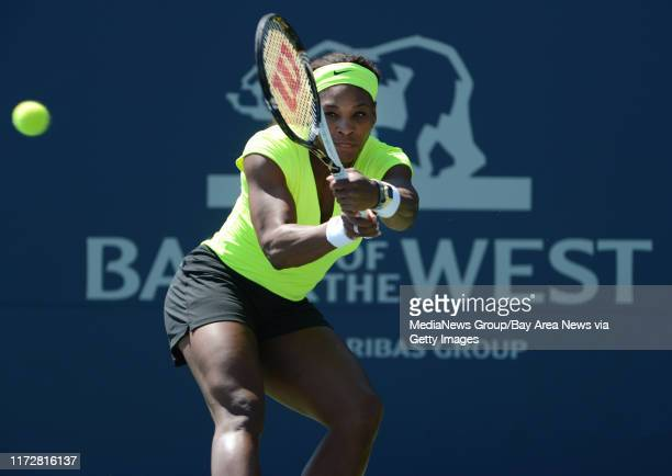 Serena Williams returns the ball in the first set of her match against Nicole Gibbs for the Bank of the West Classic tennis tournament at Taube...