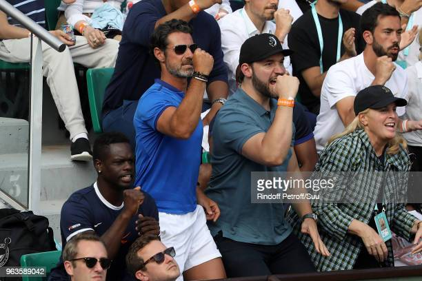 Serena Williams 's husband Alexis Ohanian and trainer Patrick Moratoglou attend the 2018 French Open Day Three at Roland Garros on May 29 2018 in...