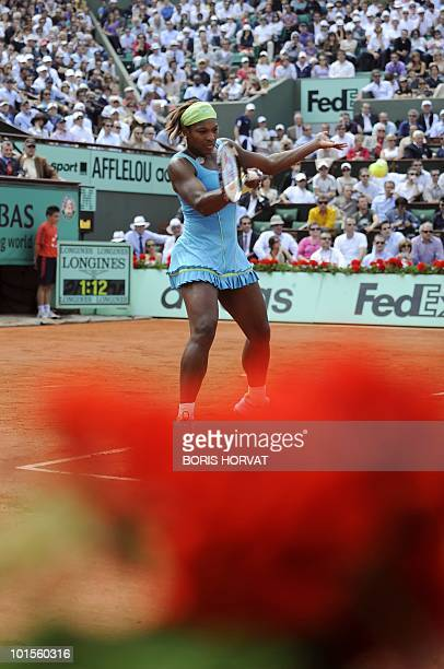 Serena Williams serves during her women's quarter-final against US Serena Williams in the French Open tennis championship at the Roland Garros...