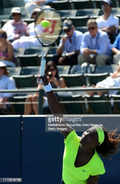 Serena Williams serves in the first set of her match against Nicole Gibbs for the Bank of the West Classic tennis tournament at Taube Family Tennis...