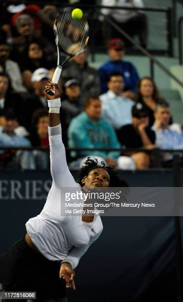 Serena Williams serves the ball against Michelle Larcher de Brito in their third set for the Bank of the West Classic in the Taube Family Tennis...