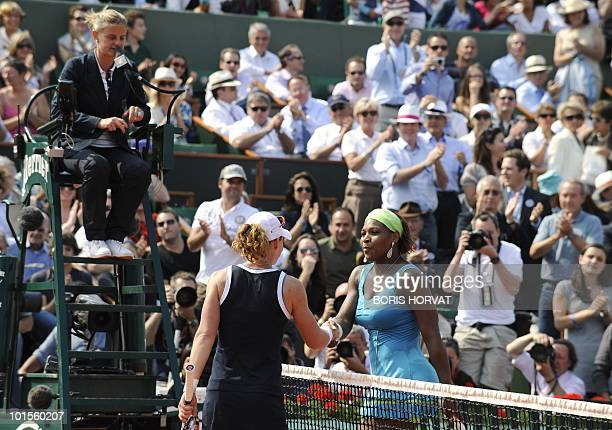 Serena Williams shakes hands with her opponent after losing her women's quarter-final against Australia's Smantha Stosur in the French Open tennis...
