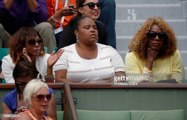 Serena Williams' sisters Venus half sister Isha Price and their mother Oracene Price attend Serena's French tennis Open round of 16 match at the...