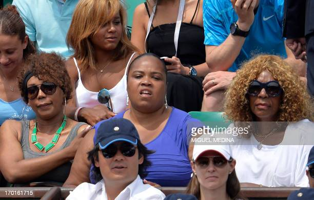 Serena Williams' sisters Venus half sister Isha Price and their mother Oracene Price attend her French tennis Open final match against Russia's Maria...